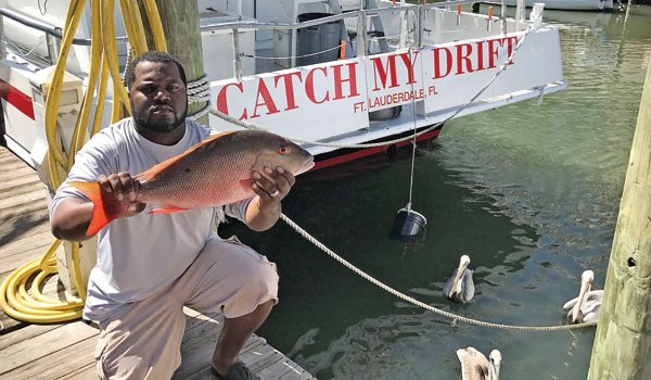 Steve from Get Some Fishing with a nice mutton he caught aboard the Catch My Drift.