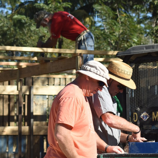 men building greenhouse
