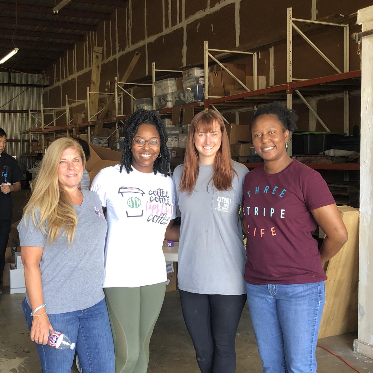 group of volunteers in warehouse