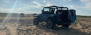 Jeep Wrangler Driving On The Beach