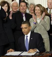 U. S. President Barack Obama signs the Patient Protection and Affordable Care Ac