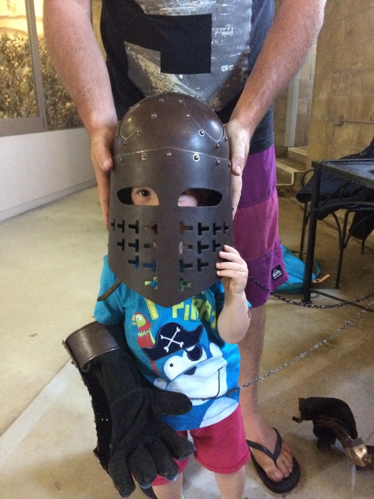 A toddler dressed up as a Knight at Sunshine Castle