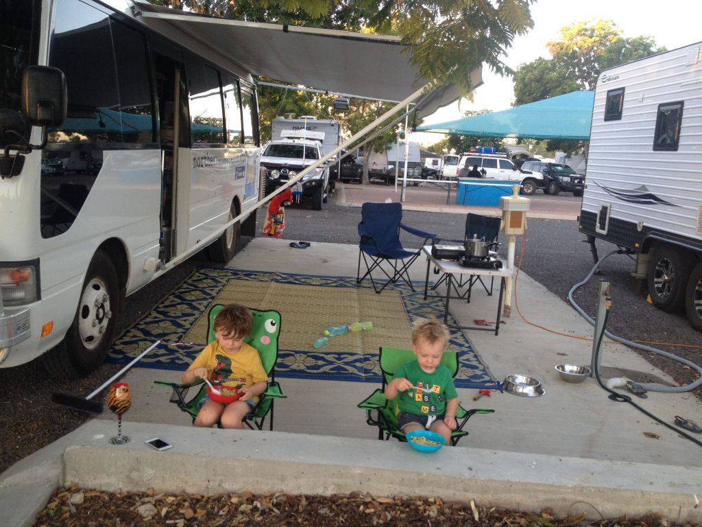 Kids eating dinner at a campground - the ultimate family camping checklist