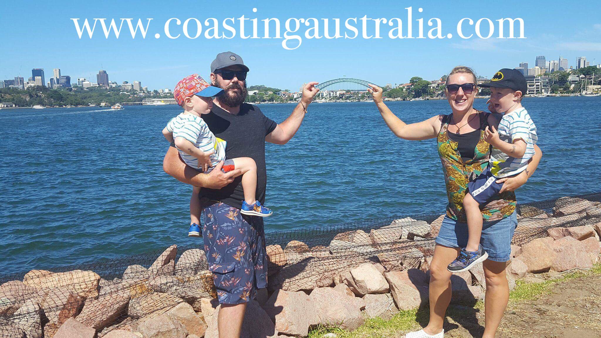 Mum, dad and 2 children in front of Sydney Harbour Bridge