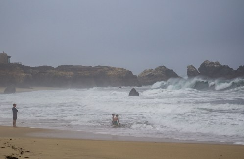 Children wading in front of 12 ft waves at Garrapata State Beach. Eek! Dawn Page/CoastsideSlacking