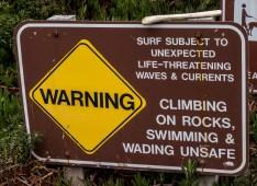 Warning sign at Garrapata State Beach. Dawn Page/CoastsideSlacking