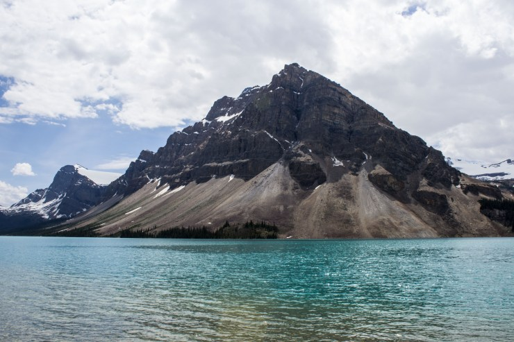 Meltwater from glaciers carry silt downstream, refracting blue and green light, forming the beautiful turquoise lake colors in Banff National Park.
