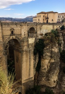 The village of Ronda is perched atop dizzying cliffs. An impressive bridge crosses a chasm separating the new and old towns. Andalusia, Spain. Dawn Page / CoastsideSlacking