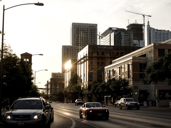 sunset in downtown Austin, mustang iand the sun reflecting on the buildings