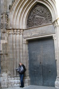 Carla standing in a doorway along the Carrer De La Pietat (Piety Street) behind the Barcelona Cathedral