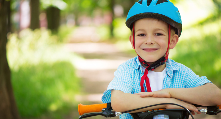 Young boy riding his bicycle