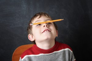 boy with adhd balancing pencil on nose