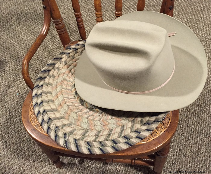 Grandpa's Hat resting on a chair.