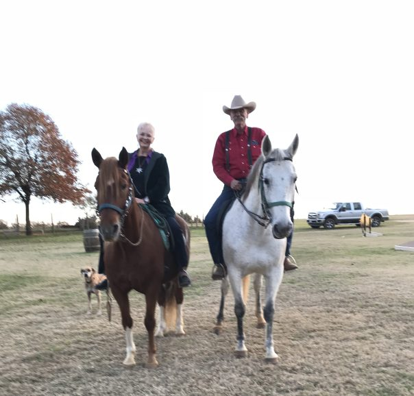 Glenn and Sally riding their horses together
