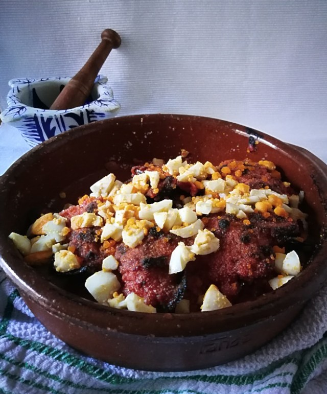 mejillones gratinados con salsa de tomate con jamón serrano