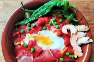 Como hacer la receta de huevos a la flamenca.
