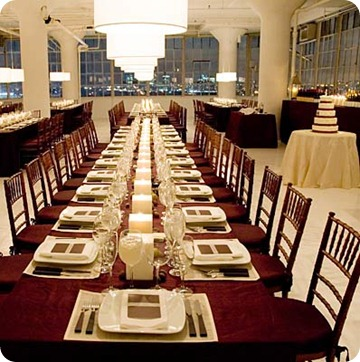 Long banquet tables have an impact with square pillars going down the center
