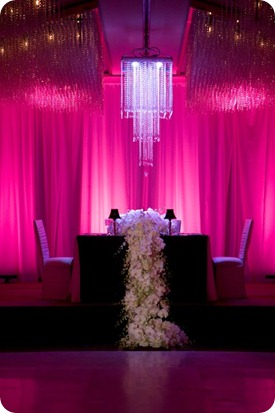 Wedding Reception with hanging crystal chandelier over table