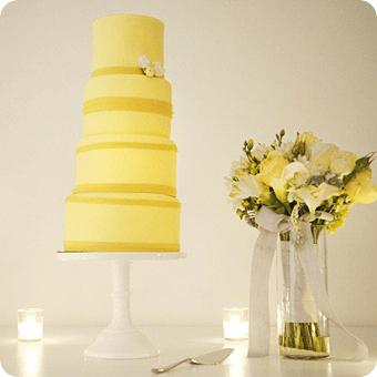 Round Yellow Wedding cake with Yellow Ribbon on white cake stand