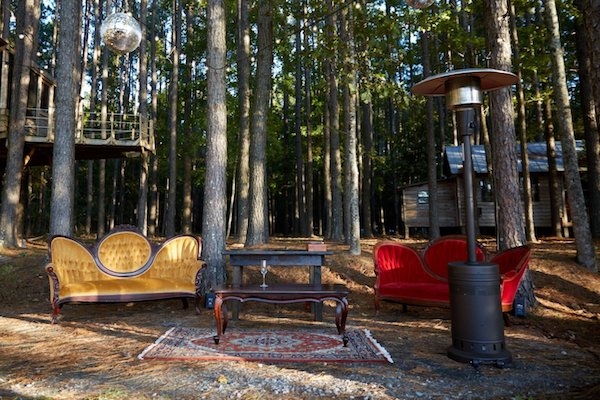 vintage lounge furniture sitting in the woods for cocktail reception