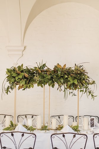long wedding reception tables with gold risers and local Georgia greenery