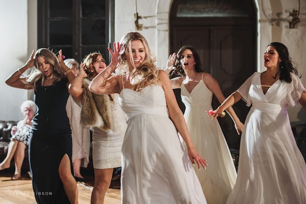 bride and friends dancing at her Crane Cottage wedding