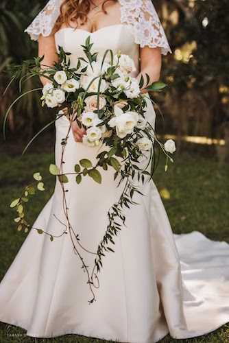 loose European style bridal bouquet in white and cream with locally sourced greenery
