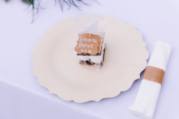 charger plates with S'mores wedding favor at a Captain's Bluff wedding reception