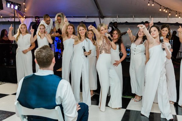 bride with an acapella performance for her groom