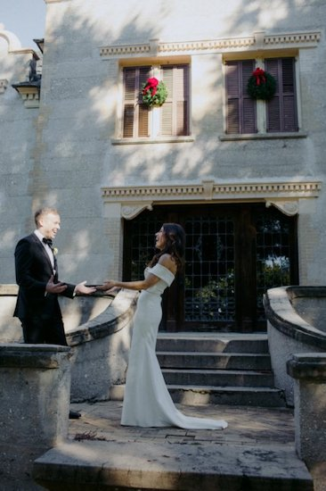 bride and groom having their first look at the historic Horton House in Jekyll Island