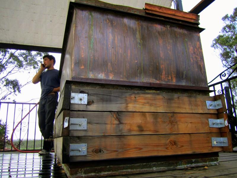 Copper fermentation vat on pedestal.