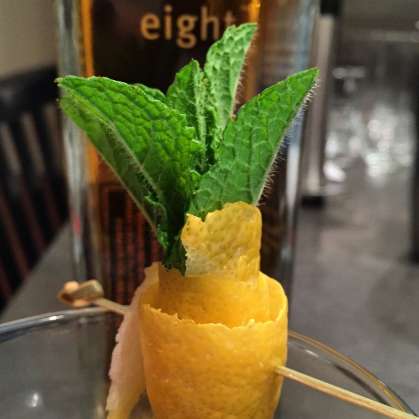 Tiki garnish with lemon peel and mint