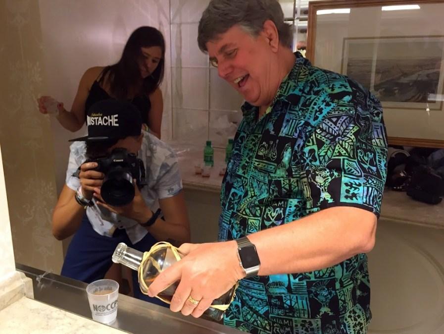Robert Burr pours rum