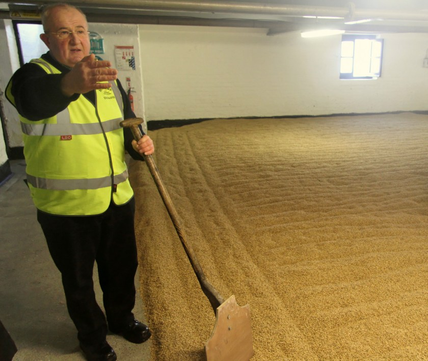 Eddie MacAffer on the malt floor, Bowmore distillery