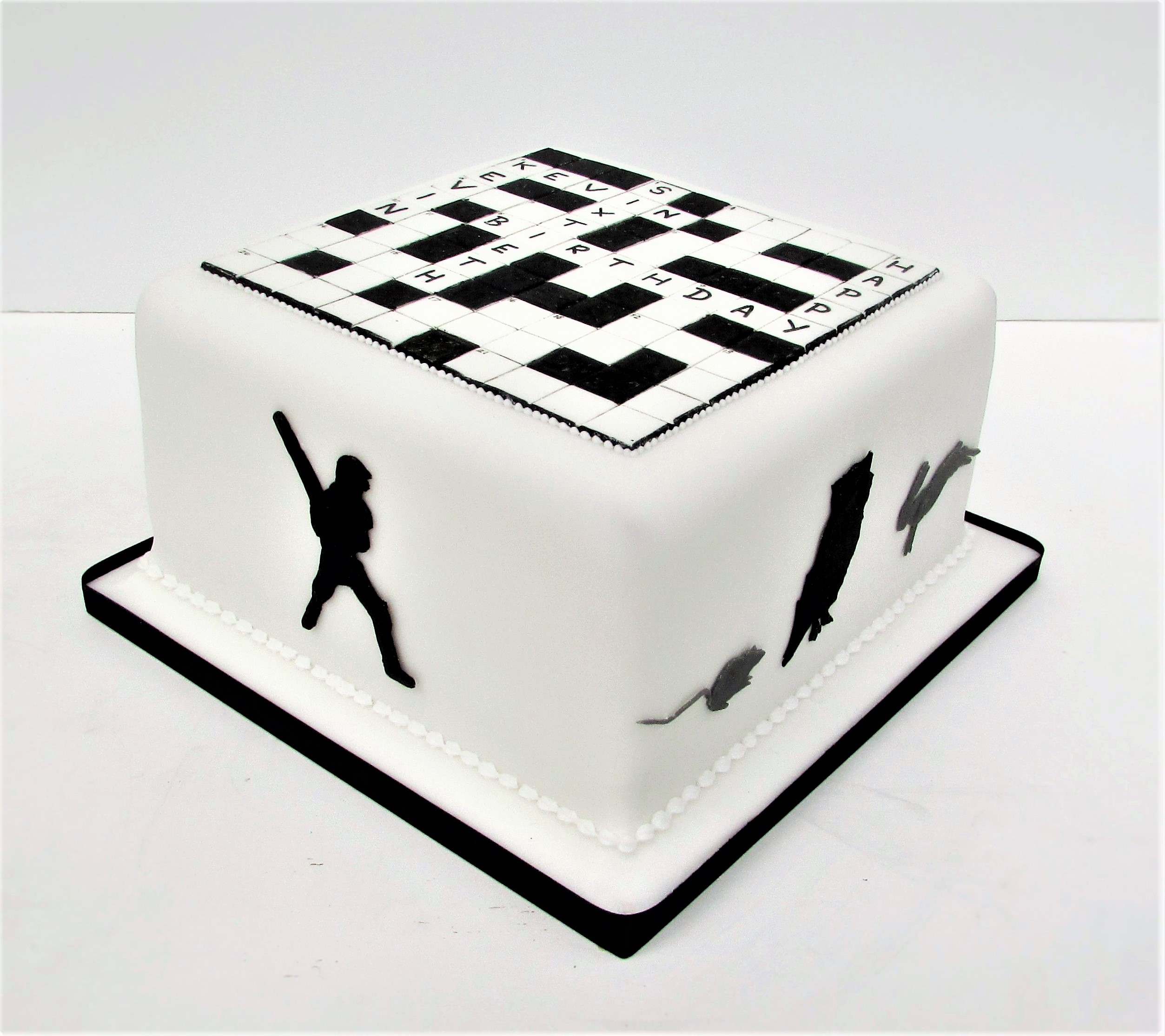 Crossword party cake with silhouette figures