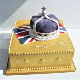 Gold party cake with Union Flag and sugar crown
