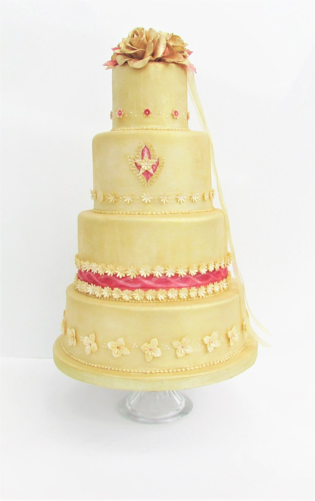 Gold Roses & Watercolour Ribbon Wedding Cake by Cocoa & Whey Cakes in Dorset