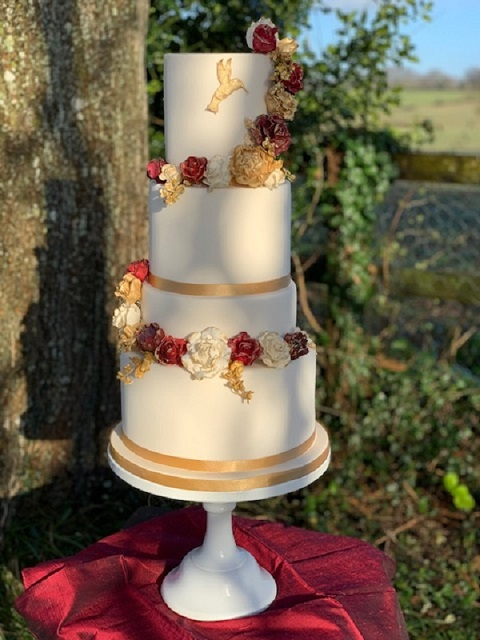 Gilded Sugar Roses & Hummingbird Wedding Cake by Cocoa & Whey Cakes in Dorset