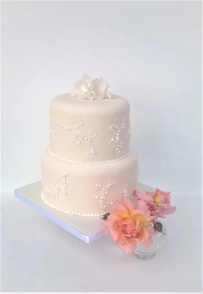 White Piped Embroidery Wedding Cake by Cocoa & Whey Cakes in Dorset