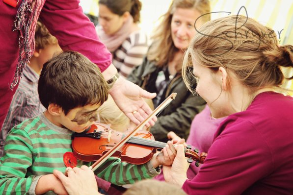 Everyone had a go on the little violins.