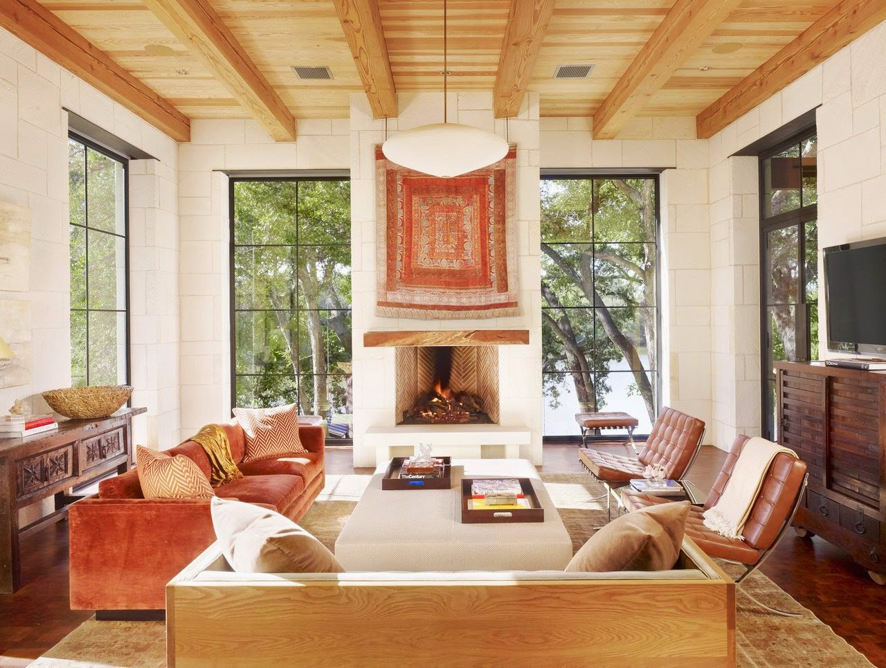 southwestern living room fireplace cococozy chairs rust