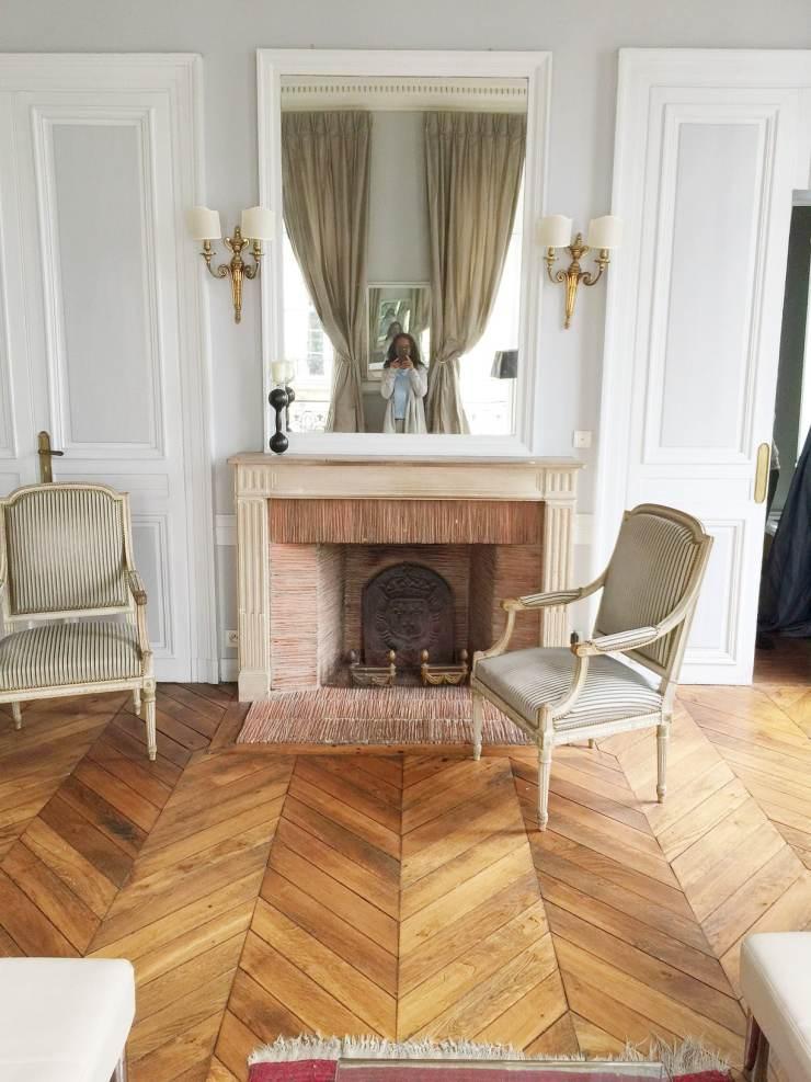 paris-apartment-fireplace-mantel-herringbone-floors-cococozy