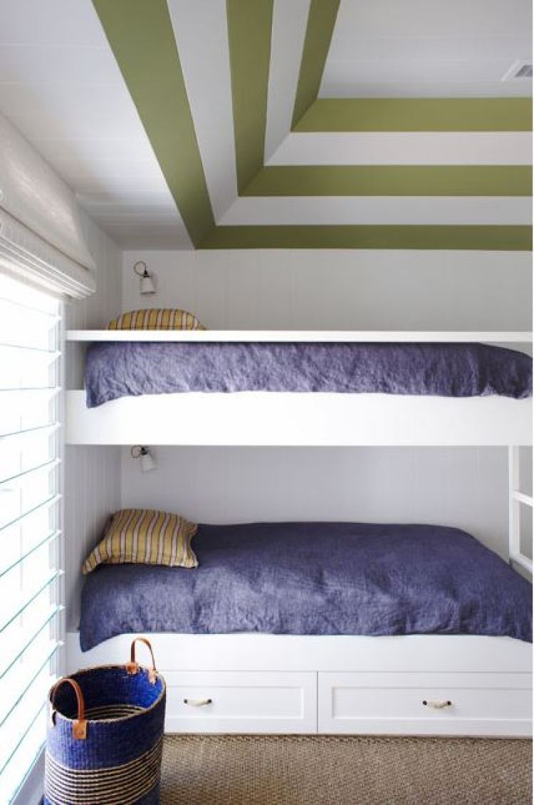 bunk beds in a bedroom with striped ceiling
