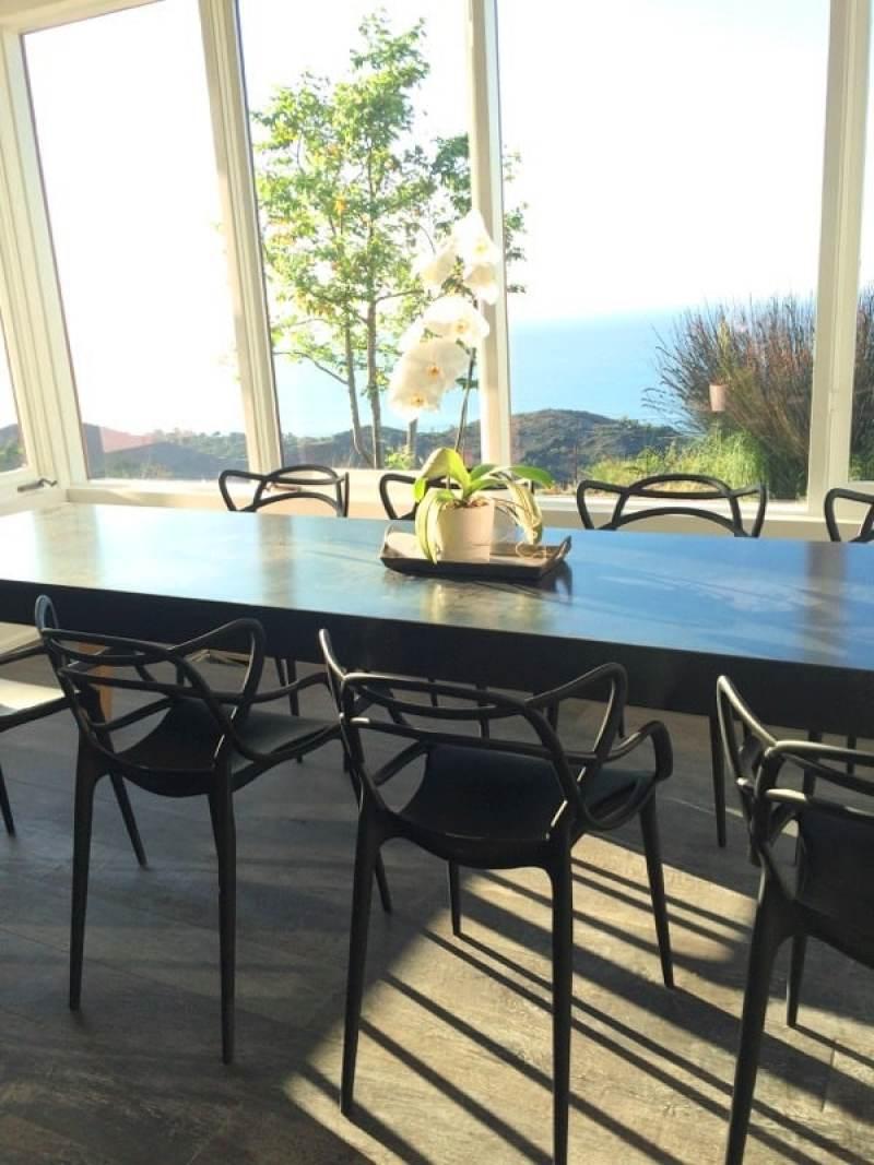 Philippe Starck Masters Chairs Malibu dining room