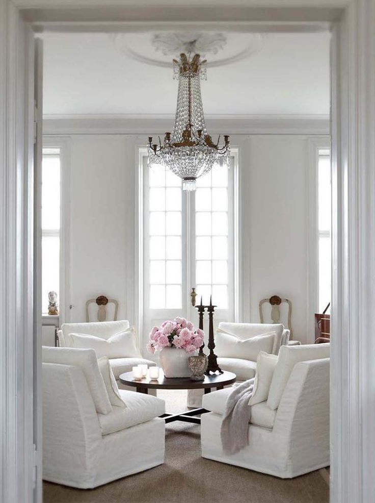 french empire chandelier living room seating group armchairs
