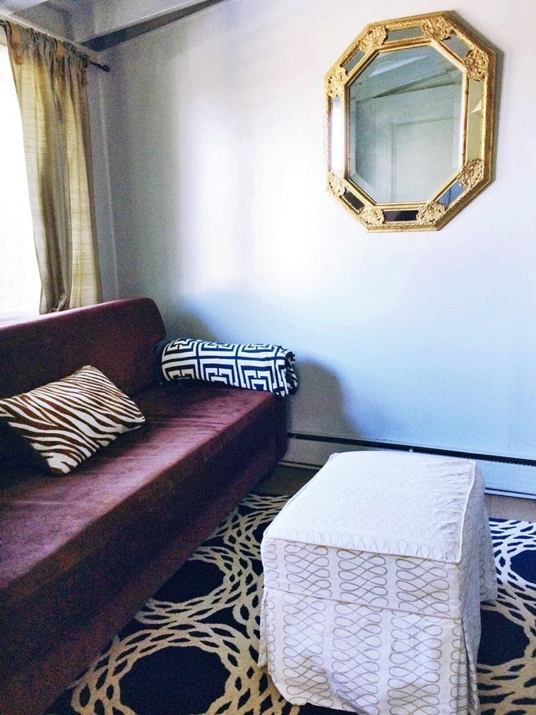 blue living room den octagonal mirror blue rug