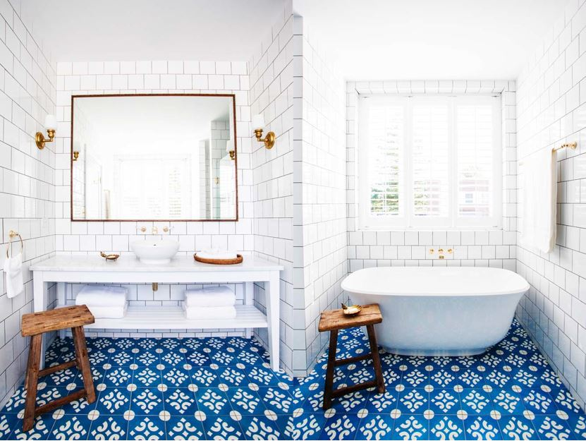 White-bathroom-stand-alone-tub-subway-tile-blue-cement-tile-floor-brass-plumbing-faucet-cococozy-halcyonhouse-blackandspiro