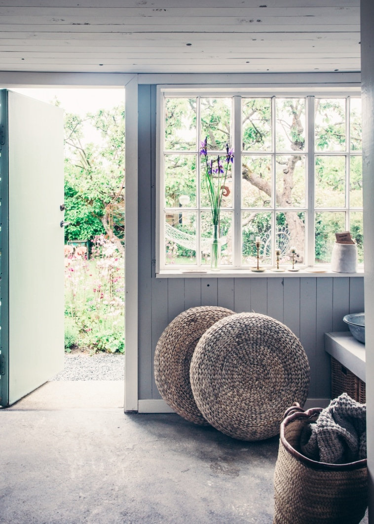 cottage-mudroom-back-porch-wicker-poufs-cushion-floor-pads-cococozy