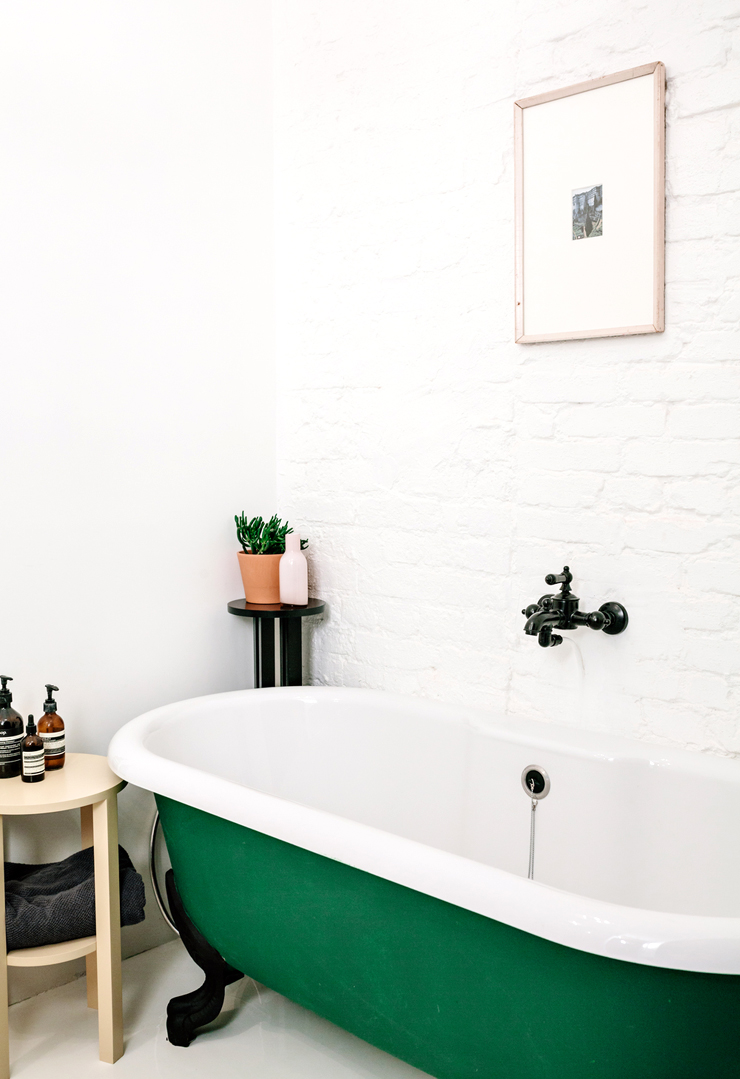 Kelly green stand alone bath tub color block bathroom