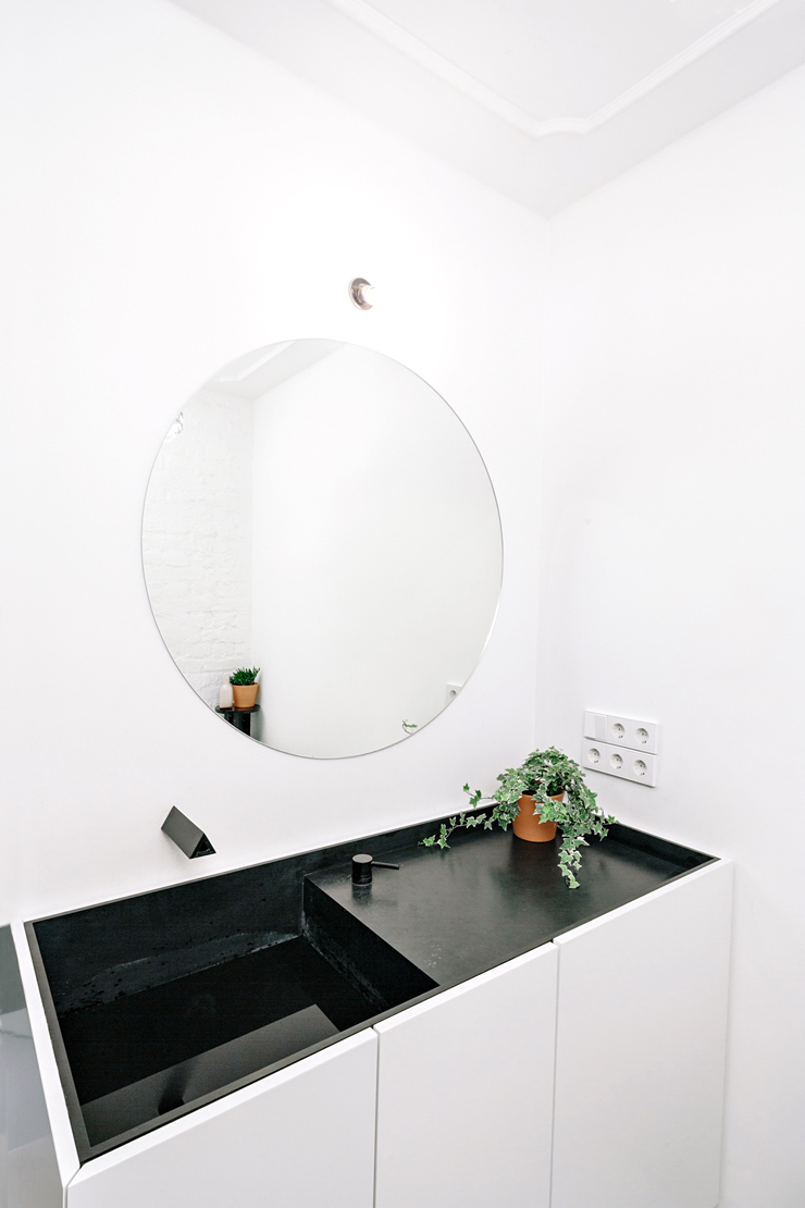 black integrated bathroom sink counter white cabinet